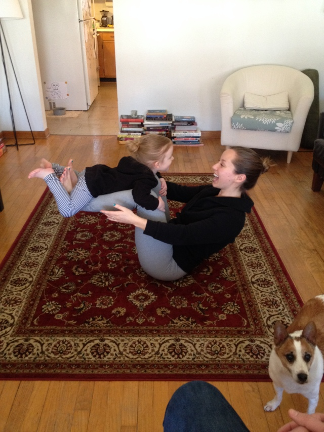 my niece and I doing yoga together in our matching outfits.